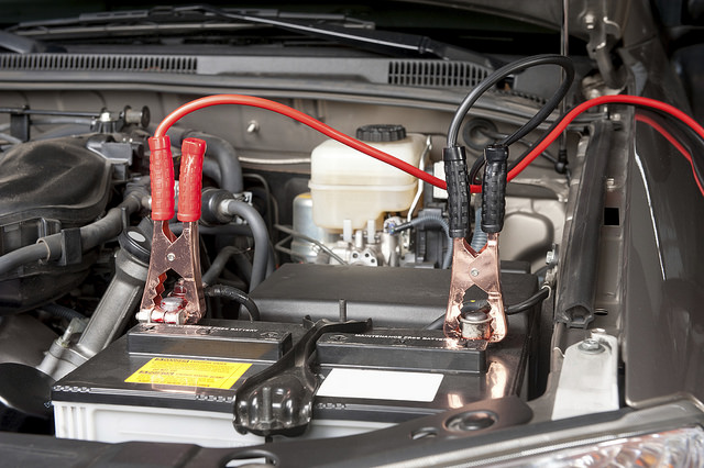 car battery with jumper cables