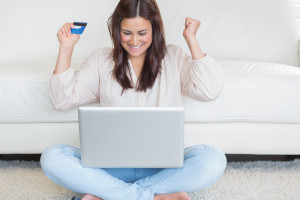 Happy woman buying something online
