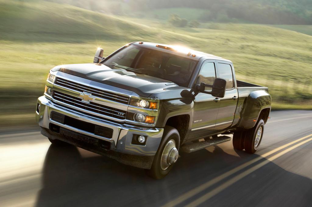 Black 2015 Silverado HD from Cincinnati Chevrolet dealers driving down a country highway