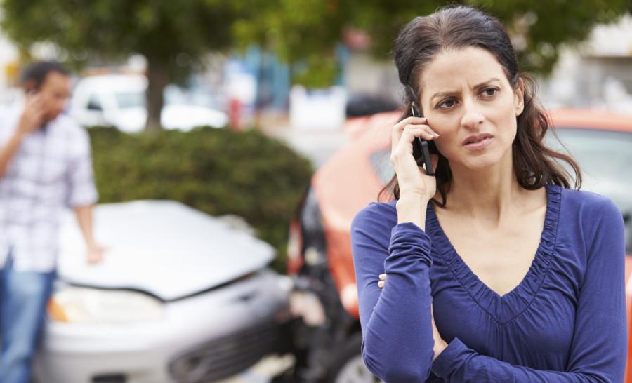 Female Driver Making Phone Call After Traffic Accident- Cincinnati Auto Repair