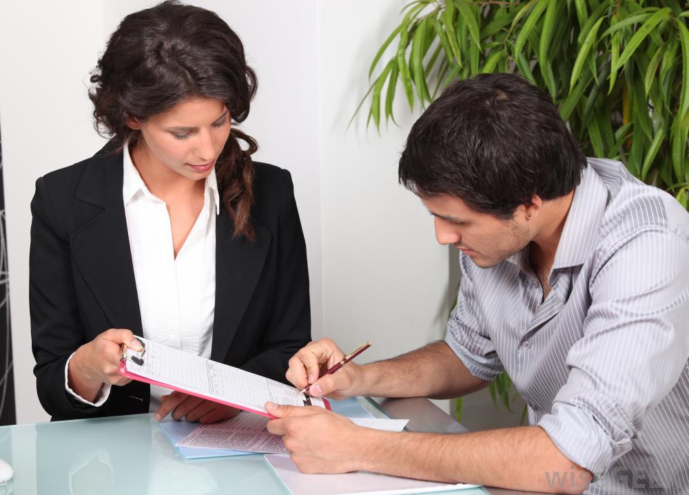 man-signing-paperwork