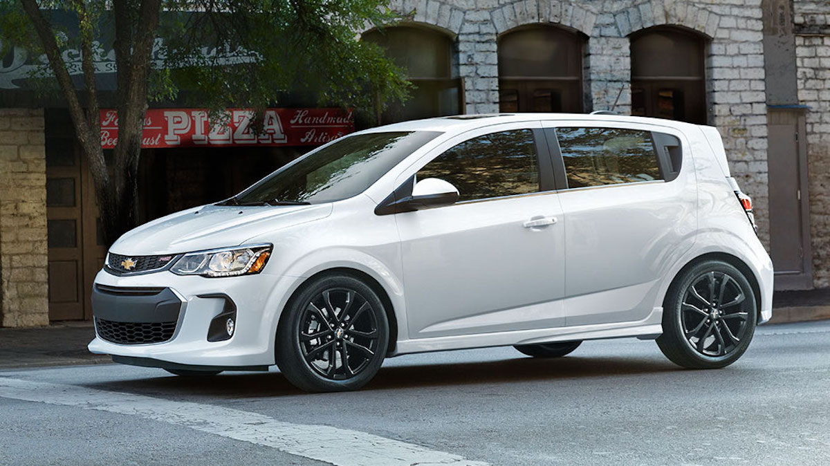 A white 2017 Chevy Sonic is stopped at a Cincinnati intersection.